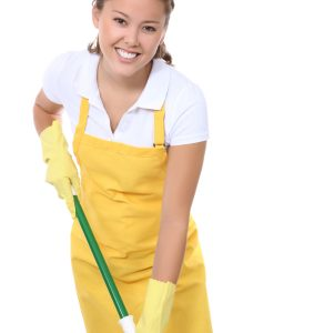 A cute young maid with mop getting ready to clean